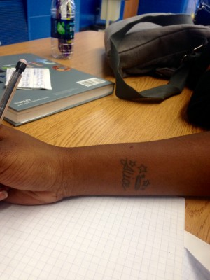 Tyneisha Lester's '16 tattoo of her grandmother's name, Alice on her wrist.