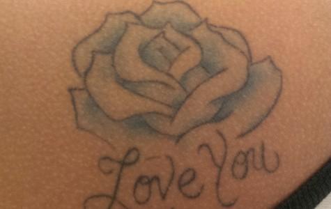 Jennifer Moran's '15 tattoo on her shoulder.