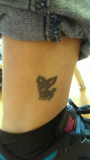 Jennifer Moran's '16 tattoo of a dog on her ankle.