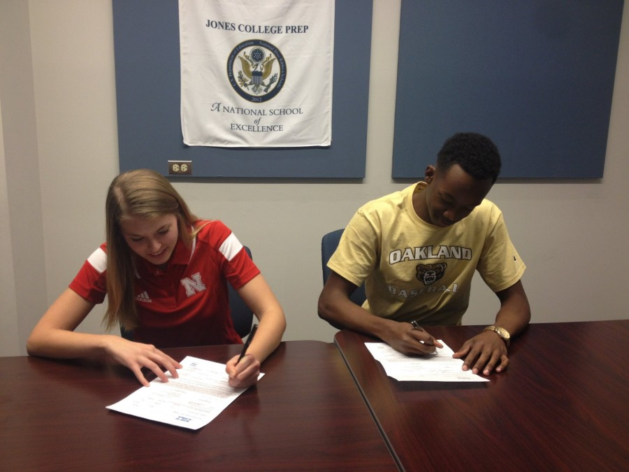 Julie Lohman '15 and Jordan Jackson '15 signing the official papers to become Division I NCAA Athletes