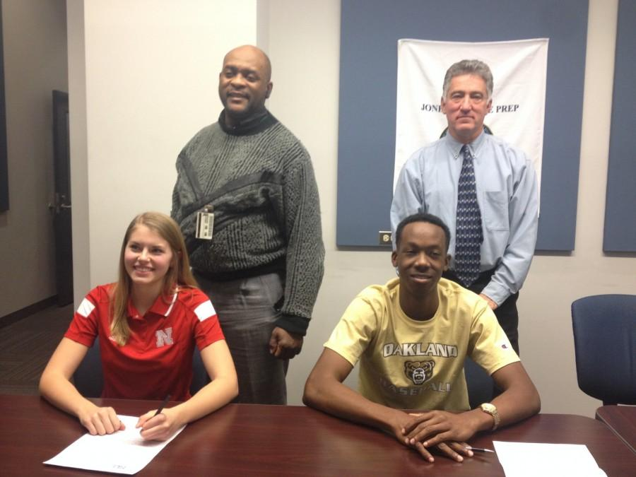 Jordan Jackson '15 and Julie Lohman '15 with their high school coaches, Frank Menzies and Dave Rosene
