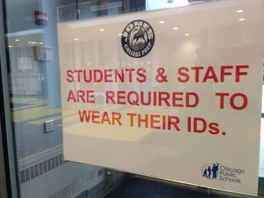 Signs inform students as they enter the building through security.