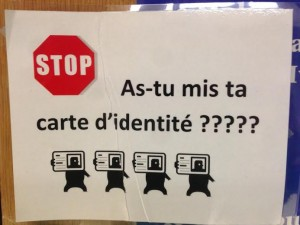 Outside a French classroom a sign reads, Where is your ID card?