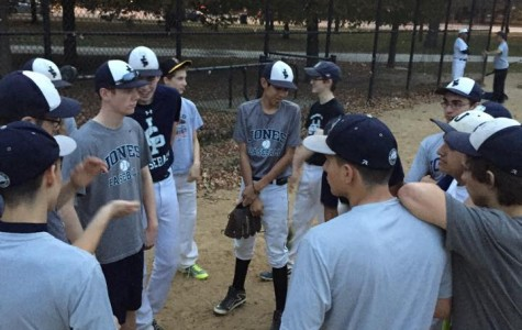 Bringing it in, the team talks about their agenda for fall practice at Washington Park.