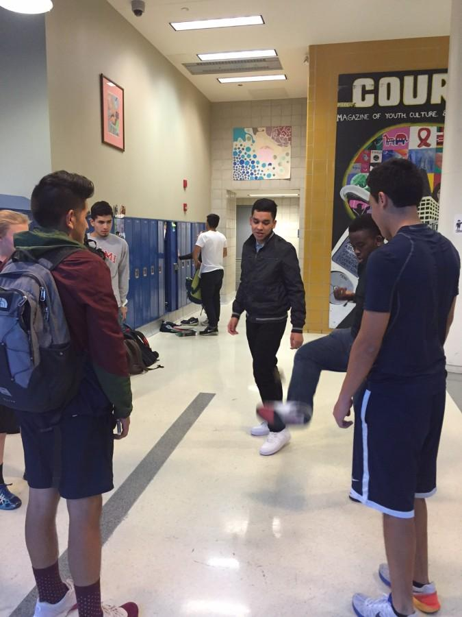 A group of students playing Hacky Sack, enjoying the relaxation it provides.