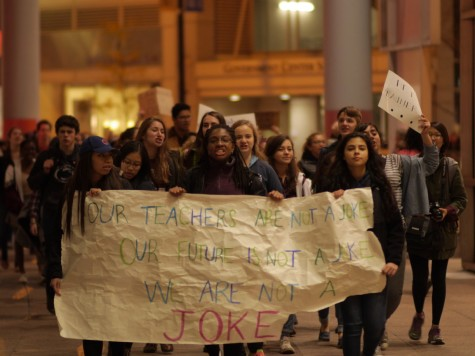 Students march outside after being locked out of the Thompson Center by police.