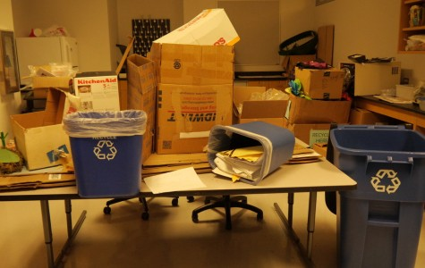 The Green Team's headquarters is packed with recyclables and bins.