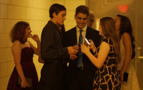 Lucas Steinbruegge and Nasko Pelinkaj, both '18, chatting with friends while choosing to attend Homecoming without dates.  A common occurrence here, going to Homecoming with friends is encouraged more than bringing a date. This year, prom will be held on May 21, 2016, in the Harold Washington Library.