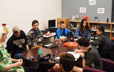 Members of the club participate in a mock caucus.