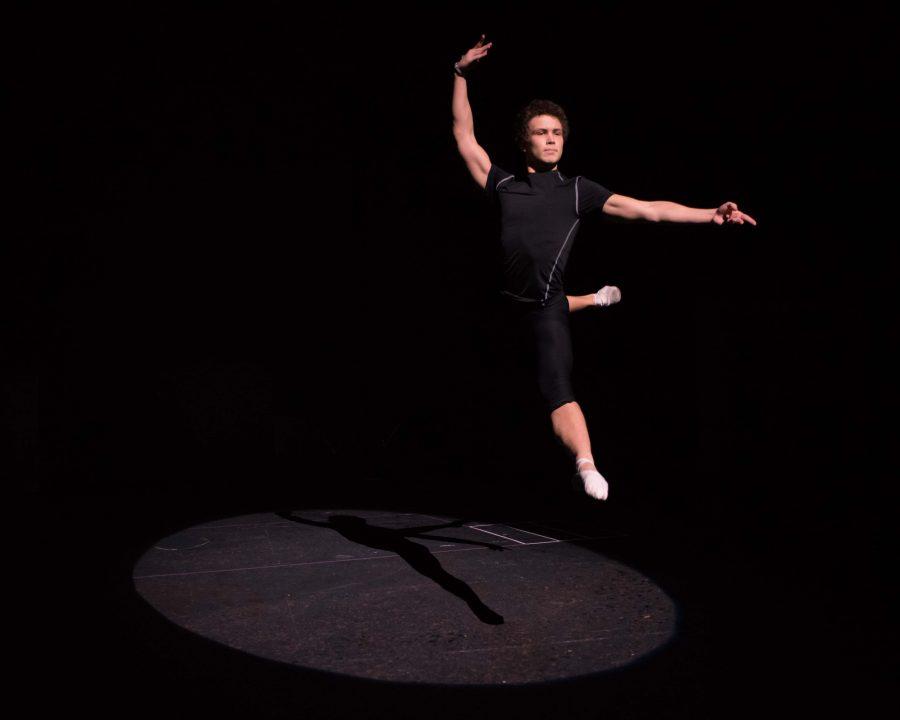 Boris Fedorov '18 leaps pre-rehearsal for Fame.