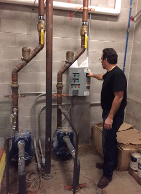 These sump pumps transfer the waste out of the pit below and must be manually turned on three times a day due to automatic system failure from improper manufacturing or installation.
