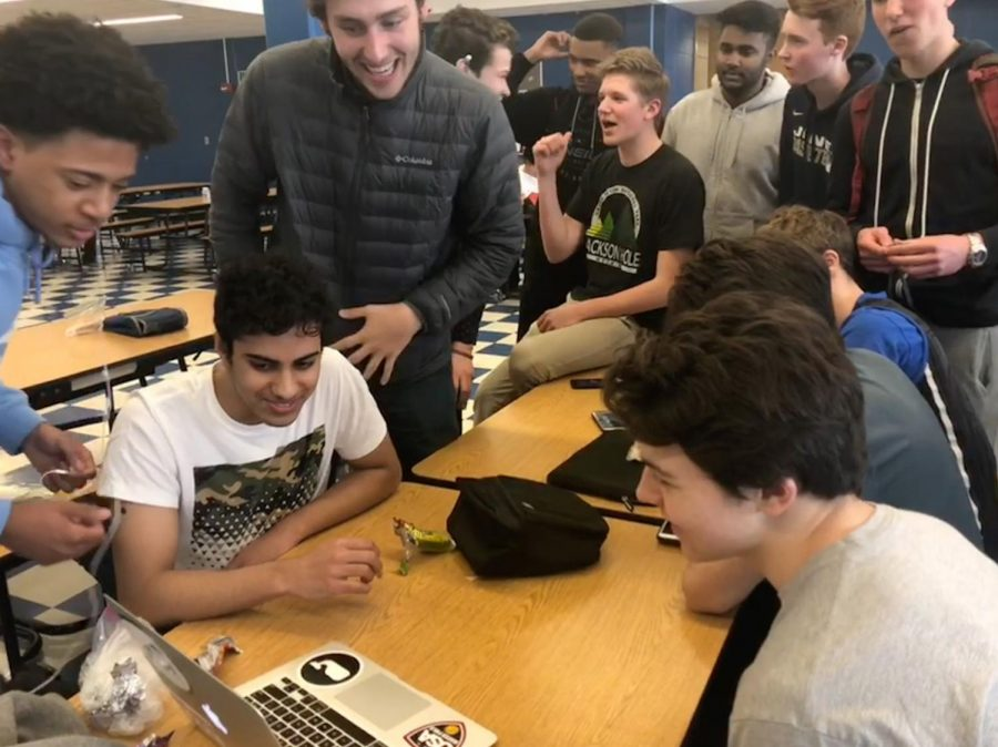 Students+huddled+around+friends%27+computers+to+watch+first+round+games+during+school+Thursday+and+Friday