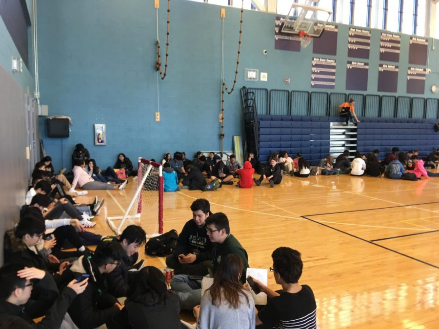 Students gathered against the walls of the gym while students left their classes for the walk out