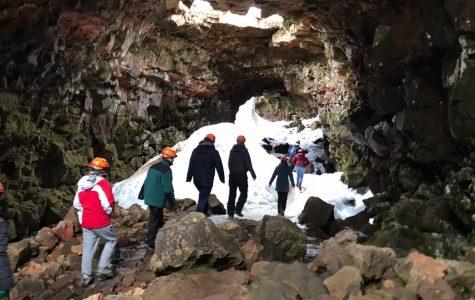 Students wander through the caves of Iceland.