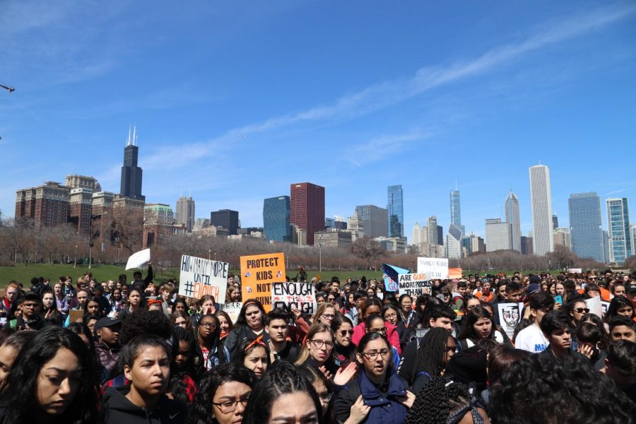 Thousands of students from multiple Chicago high schools gather in Grant Park, clad in orange and black to honor victims of gun violence.