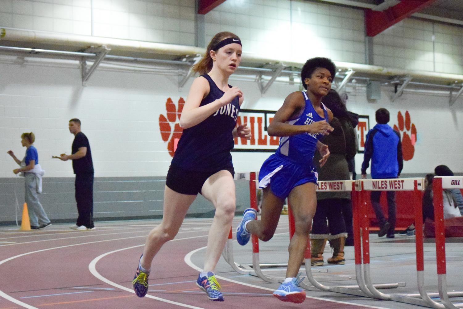 Thea Reaves competes in her first 400m as a varsity runner.