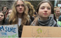 Julia Harris '20 (left) and Isabel Sices '20 (right) listen to speeches at Federal Plaza.