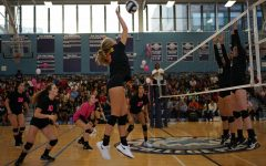 Danielle Ouimet '21 spiking at the Dig Pink game last year. Story from Volume 6, Issue 1