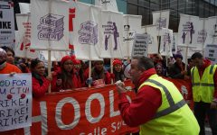 A man leads a chant to CTU, SEIU protestors on the first day of the strike last year. Photo by Josh Blustein 20.
