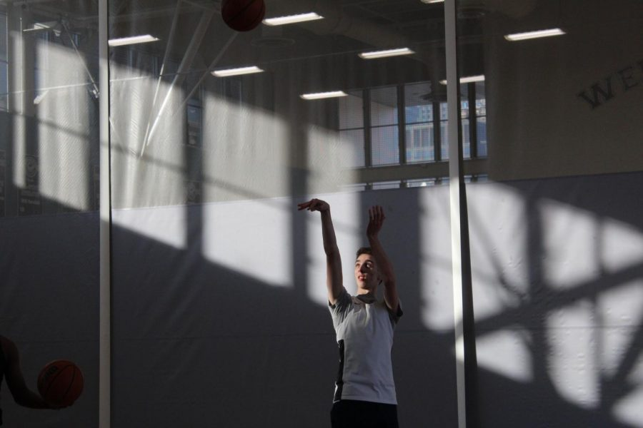 Preston Crockett '21 practicing for the boys basketball team during the COVID shortened season last year