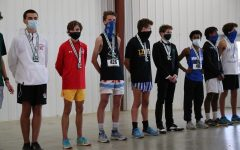 Andy Niser 21 receiving his medal for placing 18th at the Shazam XC Club Championships, good enough for All Shazam